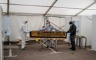 A victim of the coronavirus is brought into the temporary morgue at the Central Jamia Mosque Ghamkol Sharif in Birmingham, England. Andrew Testa for The New York Times