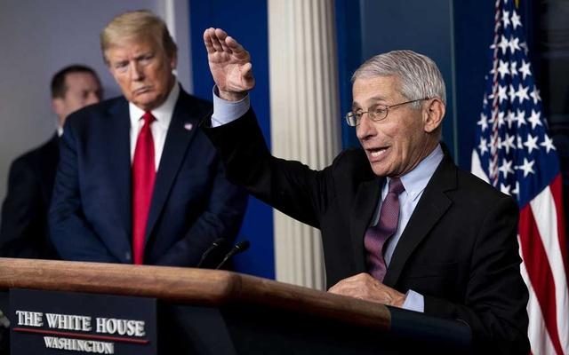 Dr Anthony Fauci, director of the National Institute of Allergy and Infectious Diseases, speaks, as President Donald Trump listens, during a coronavirus task force briefing at the White House in Washington, April 22, 2020. The New York Times.