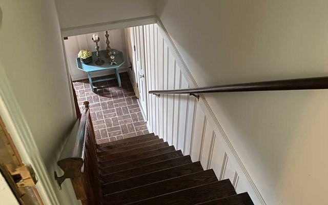 The staircase in Will Cowan's home. For those who believe they're locked down with spectral roommates, the pandemic has been less isolating than they bargained for. (via Will Cowan via The New York Times)