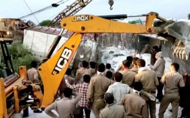 A police rescue team work to lift a truck at the site of an accident where a truck carrying migrant labourers collided with another, killing and injuring several people in Auraiya, Uttar Pradesh, India, May 16, 2020 in this still image taken from video. ANI via REUTERS TV