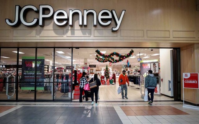 Shoppers enter and leave the JC Penney department store in North Riverside, Illinois, US, November 17, 2017. REUTERS