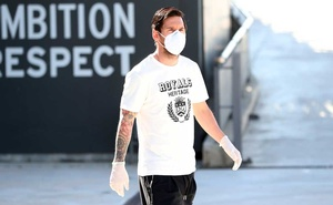 FC Barcelona's Lionel Messi wearing a protective face mask and gloves at Ciutat Esportiva Joan Gamper training ground for COVID-19 tests following the outbreak of the coronavirus disease (COVID-19), Barcelona, Spain, May 6, 2020. REUTERS.