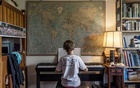 Hannah Beech's elder son practises piano at their home in Bangkok. THE NEW YORK TIMES