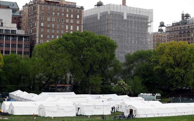 People walk near the Samaritan's Purse Emergency Field Hospital in Central Park as the outbreak of the coronavirus disease (COVID-19) continues in the Manhattan borough of New York US, May 8, 2020. REUTERS