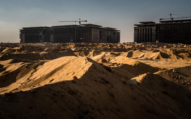 Construction workers in the first phase of Cairo's new capital that is under construction on Aug 9, 2018. The New York Times