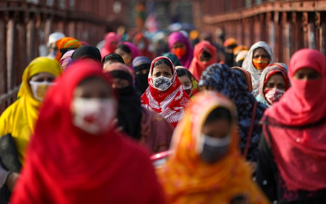Garment workers return from a workplace as factories reopened after the government has eased the restrictions amid concerns over the coronavirus disease (COVID-19) outbreak in Dhaka, Bangladesh, May 4, 2020. REUTERS
