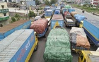 Hundreds of vehicles, mostly covered vans, waiting at Sanarpar on the Dhaka-Chattogram Highway for entry into Dhaka on Wednesday as the police are not allowing anyone into the capital without valid reason amid the coronavirus outbreak.