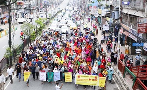 Disgruntled garment workers of Dragon Sweater Bangladesh Ltd brought out a procession at Malibagh Chowdhury Para in Dhaka on Wednesday to demand payment of wages and Eid allowance. Photo: Mahmud Zaman Ovi