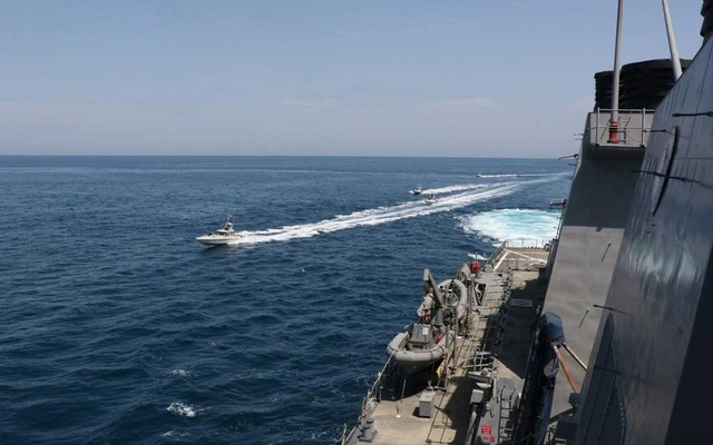 FILE PHOTO: Four Iranian Islamic Revolutionary Guard Corps Navy (IRGCN) vessels, some of several to manoeuvre in what the US Navy says are