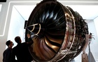 A man looks at Rolls Royce's Trent Engine displayed at the Singapore Airshow in Singapore February 11, 2020. REUTERS