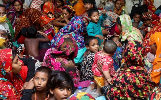 People gather at a storm centre in Satkhira for protection from Cyclone Amphan on May 20. REUTERS