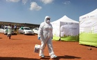A member of medical staff arrives for a screening and testing campaign aimed to combat the spread of the coronavirus disease (COVID-19), in Lenasia, South Africa, Apr 21, 2020. REUTERS