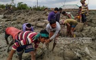 Locals repair the dam at the river of Chuna in Burigoalini, Shyamnagar destructed by cyclone Amphan. Photo: Tomzid Mollick