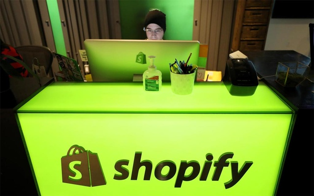 FILE PHOTO: An employee works at Shopify's headquarters in Ottawa, Ontario, Canada, October 22, 2018. Reuters