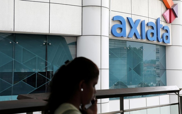 A woman walks past the Axiata headquarters building in Kuala Lumpur, Malaysia, October 1, 2019. Reuters