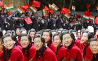File photo of students wearing masks of China's President Xi Jinping as others wave national flags of India and China, ahead of the informal summit with India's Prime Minister Narendra Modi, at a school in Chennai, India, October 10, 2019. REUTERS