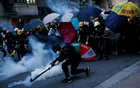 Demonstrators clash with police during a protest against police violence during previous marches, near China's Liaison Office in Hong Kong on July 28, 2019. FILE/REUTERS