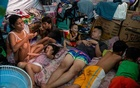 Veronico Alfonso Jr, 35, and his family stay inside their tent at a makeshift evacuation centre for residents whose houses were engulfed by a fire months ago, amid the coronavirus disease (COVID-19) lockdown, in Mandaluyong City, Metro Manila, Philippines, May 19, 2020. REUTERS
