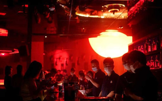 People wear face masks at a nightclub after it reopens, following a shutdown due to the coronavirus disease (COVID-19) outbreak, in Shanghai, China May 22, 2020. REUTERS/Aly Song