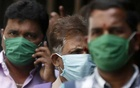 Men wearing protective masks walk inside the premises of a hospital where a special ward has been set up for the coronavirus disease in Mumbai, India, Mar 17, 2020. REUTERS