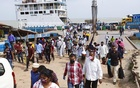 People disembarking from a ferry at Shimulia pier as they return to Dhaka after Eid-ul-Fitr amid the coronavirus outbreak.Photo: Mahmud Zaman Ovi