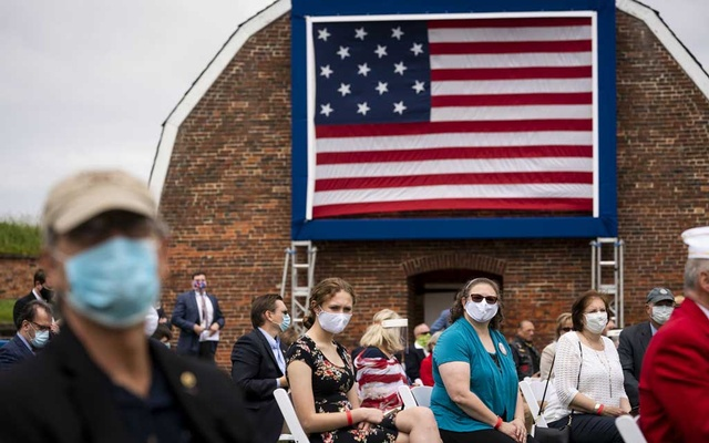 An audience looks on as President Donald Trump and first lady Melania Trump participate in a Memorial Day Ceremony at Fort McHenry National Monument and Historic Shrine in Baltimore, on Monday, May 25, 2020. The New York Times