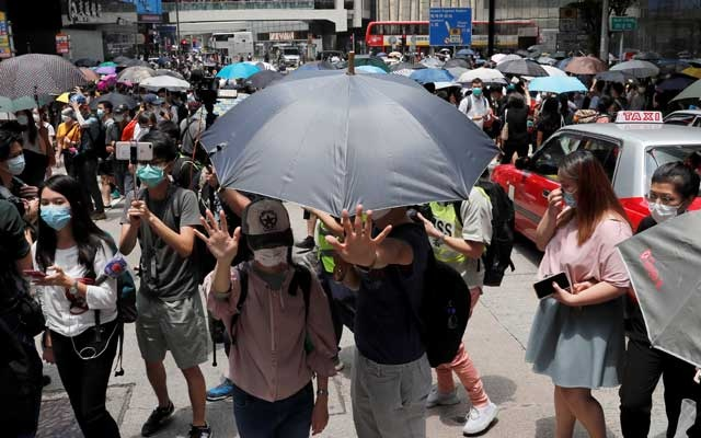 People wearing face masks take part in a protest against the second reading of a controversial national anthem law in Hong Kong, China May 27, 2020. REUTERS
