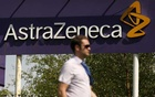 FILE PHOTO: A man walks past a sign at an AstraZeneca site in Macclesfield, central England May 19, 2014. Reuters