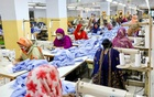 Women work in a garment factory, as factories reopened after the government has eased the restrictions amid concerns over the coronavirus disease (COVID-19) outbreak in Dhaka, Bangladesh, May 3, 2020. REUTERS