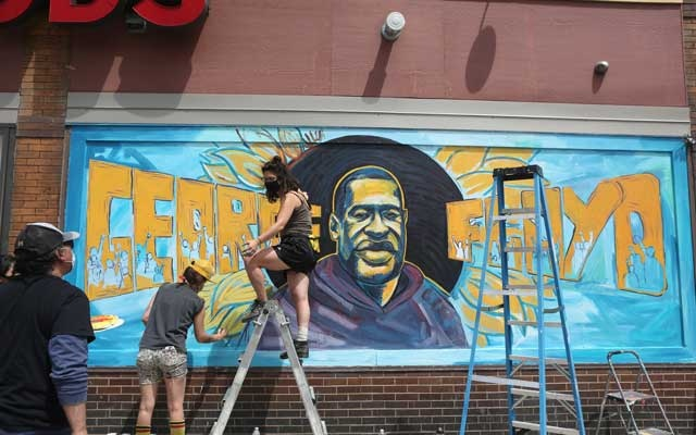 A mural depicting George Floyd in Minneapolis on Thursday, May 28, 2020. Police departments have tried to ban or severely limit the use of neck restraints — but, in Minneapolis, a knee pressing on a neck for eight minutes led to a man's death. The New York Times