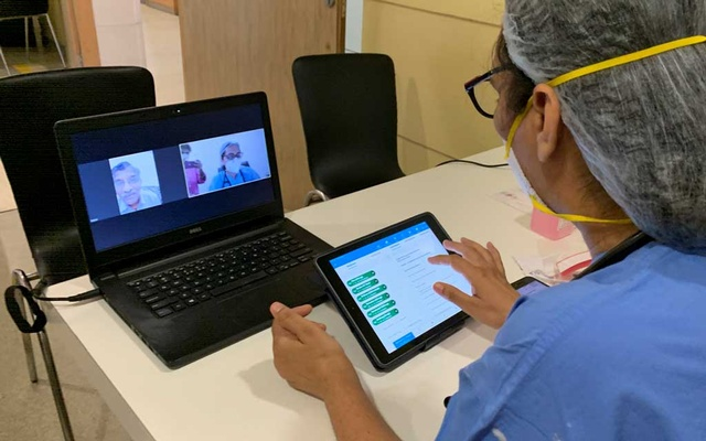Doctor Sushila Kataria gives consultation to a patient via video call, amid the spread of the coronavirus disease (COVID-19), at Medanta Hospital in Gurugram, India, May 22, 2020. REUTERS