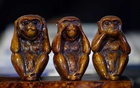A sculpture of monkeys is pictured on the desk of Christian Sideris, founder of detective agency Seeclop, during an interview with Reuters amid the coronavirus disease (COVID-19) outbreak in Geneva, Switzerland April 28, 2020. REUTERS