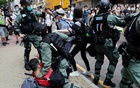 Anti-government demonstrators scuffle with riot police during a lunch time protest as a second reading of a controversial national anthem law takes place in Hong Kong, China May 27, 2020. REUTERS