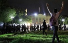 A protester holds his hands up as police officers enter Lafayette Park during a demonstration against the death in Minneapolis police custody of African-American man George Floyd, as the officers keep demonstrators away from the White House during a protest in Washington, US May 30, 2020. Reuters