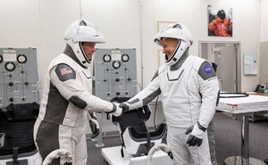 A Jan. 17, 2020 photo provided by NASA shows astronauts Robert Behnken, left, and Douglas Hurley donning their spacesuits during a dress rehearsal of SpaceX's uncrewed In-Flight Abort Test at Kennedy Space Center in Florida. On Wednesday, May 27, weather permitting, Behnken and Hurley are to be sitting on top of a SpaceX rocket headed to orbit. (Kim Shiflet/NASA via The New York Times)