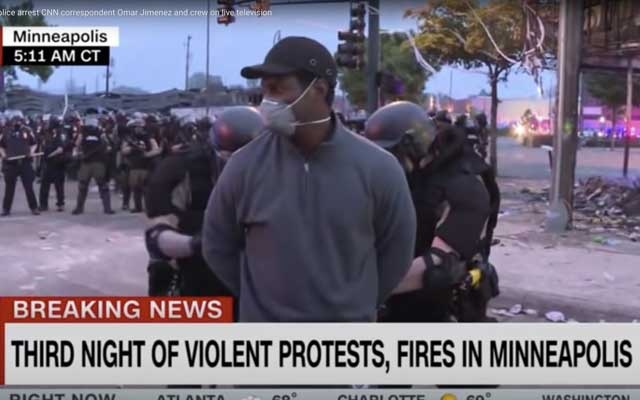 A photo provided by CNN, CNN reporter Omar Jimenez is arrested while covering the Minneapolis protests, May 29, 2020. The New York Times