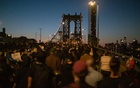 Demonstrators march across the Manhattan Bridge in New York, May 31, 2020. The New York Times