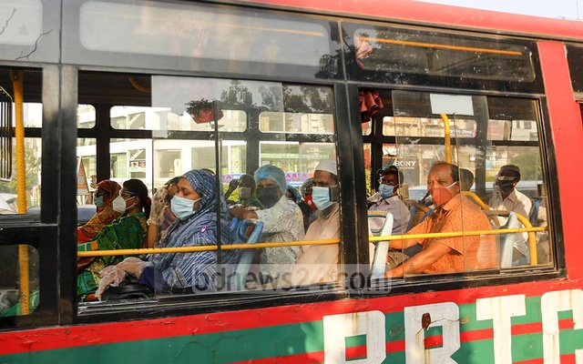 Employees of Bangladesh Rural Development Board keep no social distance despite coronavirus infection risks as they travel by bus in Dhaka. Photo: Asif Mahmud Ove