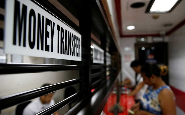 Customers receive money from families working abroad at a money remittance centre in Makati City, Metro Manila, Philippines, September 19, 2018. REUTERS