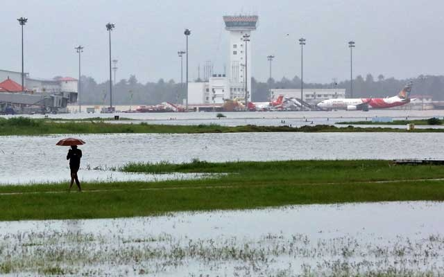 A man walks inside the flooded Cochin international airport after the opening of Idamalayar, Cheruthoni and Mullaperiyar dam shutters following heavy rain, on the outskirts of Kochi, India, August 15, 2018. REUTERS