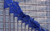 European Union flags fly outside the European Commission headquarters in Brussels, Belgium, Feb 19, 2020. REUTERS