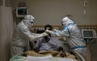 FILE PHOTO: Medical workers wearing personal protective equipment (PPE) take care of a patient suffering from the coronavirus disease (COVID-19), at the Intensive Care Unit (ICU) of the Max Smart Super Speciality Hospital in New Delhi, India, May 28, 2020. REUTERS