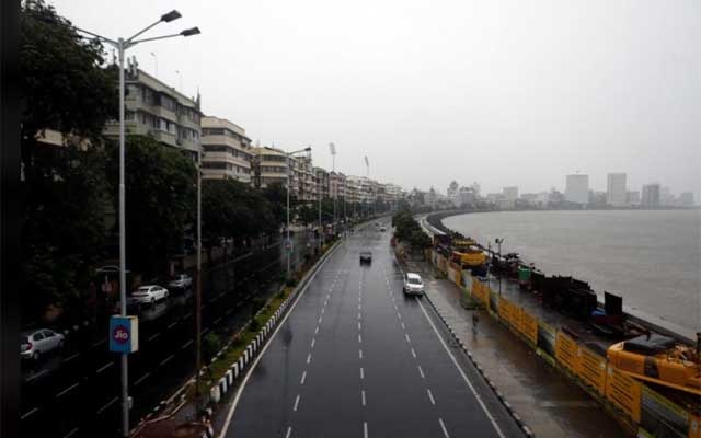 A deserted road is seen at Marine Drive before cyclone Nisarga makes its landfall, in Mumbai, India, June 3, 2020. REUTERS