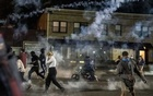 Tear gas is deployed on a crowd of protesters in Ferguson, Mo, on Sunday, May 31, 2020. The New York Times