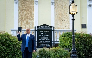 President Donald Trump holds a bible, for a photo opportunity, as he stands outside the boarded up St John's Episcopal Church in Washington, Jun 1, 2020. The president has a long history of contradictory remarks about the book he held up after forcibly clearing protesters for a photo op on Monday. The New York Times