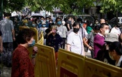 Residents wearing face masks line up for nucleic acid testings at a residential compound in Wuhan, the Chinese city hit hardest by the coronavirus disease (COVID-19) outbreak, Hubei province, China May 17, 2020. REUTERS