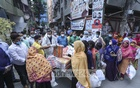 Jubo League activists distributing aid among more than 500 people with hearing disability without maintaining social distancing rules at Mirpur's Pallabi in Dhaka on Thursday amid the crisis triggered by the coronavirus outbreak. Photo: Asif Mahmud Ove