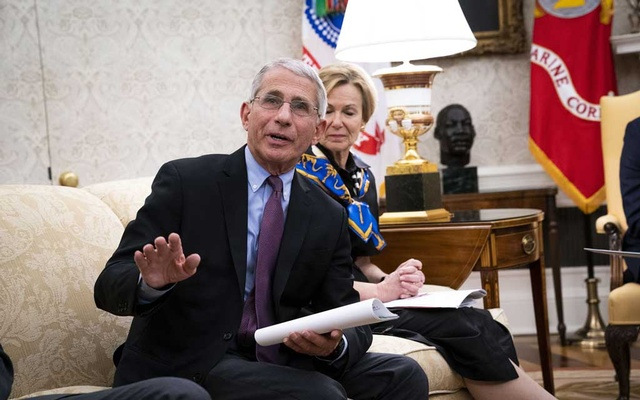FILE -- Dr. Anthony Fauci, director of the National Institute of Allergy and Infectious Diseases, comments during an event at White House in Washington, April 29, 2020. Despite promising early results and the Trump administration's strong interest in nurturing a government-industry partnership, substantial hurdles remain, and many scientists consider President Donald Trump's goal of having a vaccine widely available by early next year to be optimistic, if not unrealistic. (Doug Mills/The New York Times)