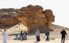 Visitors tour near Rock formations that resemble human face at the Madain Saleh antiquities site in Al-Ula, Saudi Arabia, January 31, 2020. REUTERS