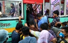 People huddle to get on a bus after the government has eased restrictions on public transport amid concerns over the coronavirus outbreak in Dhaka on Jun 4. REUTERS